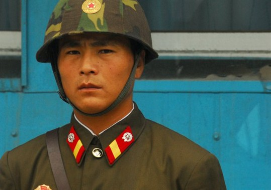 A North Korean soldier stands guard at the Korean Demilitarized Zone.