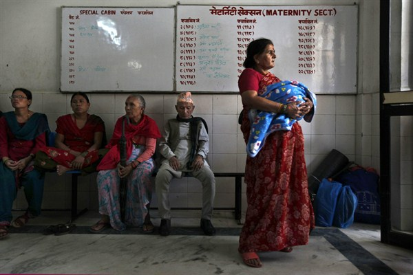 A woman in Nepal holds her newborn at a government maternity hospital.