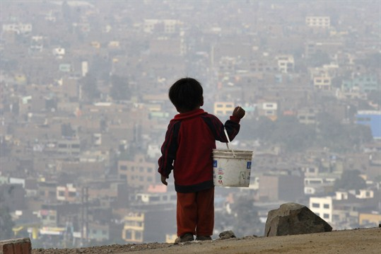 A child looks over Lima, where a rising Peruvian economy is creating new challenges.