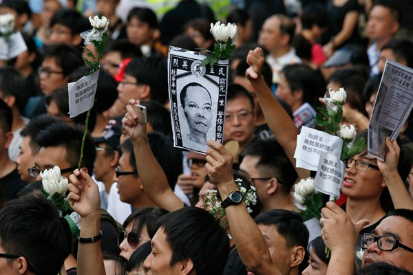 Thousands of protesters mourn Chinese labor activist Li Wangyang's death, Hong Kong, June 10, 2012.