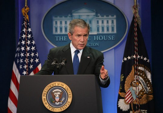 U.S. President George W. Bush behind the podium at a press conference in 2007.