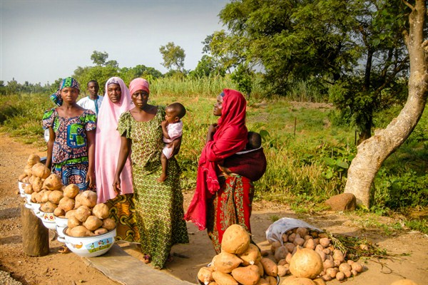Women selling sweet potatoes, Kwarra, Nigeria.