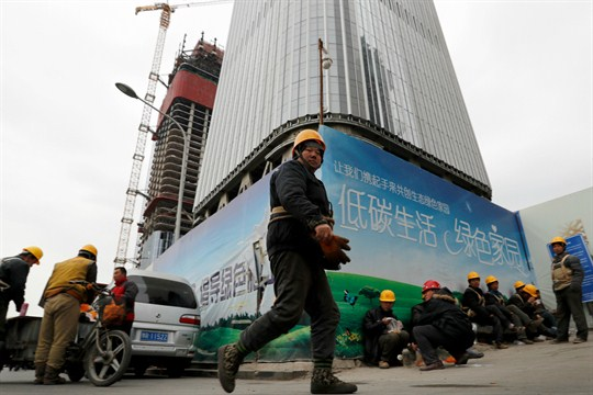 Workers take a lunch break outside a construction site in Beijing, China.