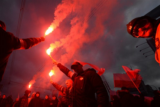 Nationalists burn flares during a march to mark Poland's Independence Day in Warsaw.
