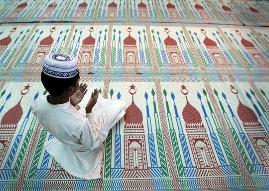 A Nepali Muslim boy prays on the second day of Ramadan at a mosque in Kathmandu.