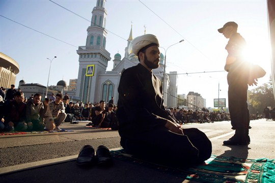 Muslims pray outside a Moscow mosque.
