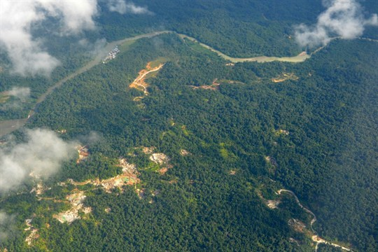 An aerial view of the rain forest, including the destruction caused by gold mining Colombia.