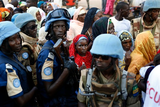U.N. peacekeepers stand near people queuing to enter a mosque in the Central African Republic.
