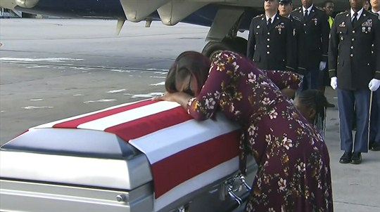 Myeshia Johnson cries over the casket of her husband, who was killed in Niger.