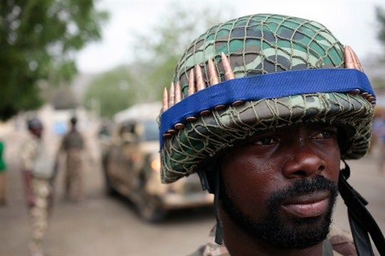 Nigerian soldiers man a checkpoint in Gwoza, Nigeria.