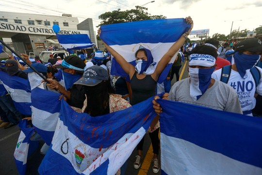 Anti-government protesters march outside Central American University, Managua, Nicaragua.