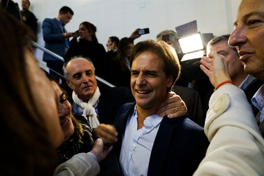 Uruguayan presidential hopeful Luis Lacalle Pou celebrates after being elected candidate the Nacional Party.