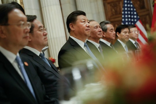 Chinese President Xi Jinping and members of his official delegation listen to U.S. President Trump speak.