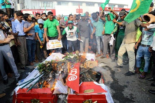 Supporters of ousted Prime Minister Ranil Wickremesinghe burn coffins to protest the government of Mahinda Rajapaksa.