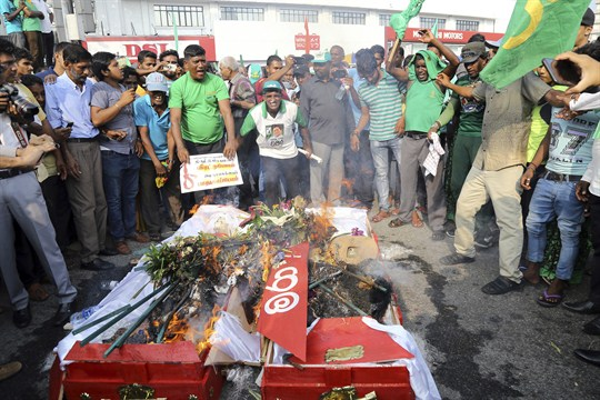 During the crisis in Sri Lankan politics, demonstrators burned coffins to protest a disputed appointment.