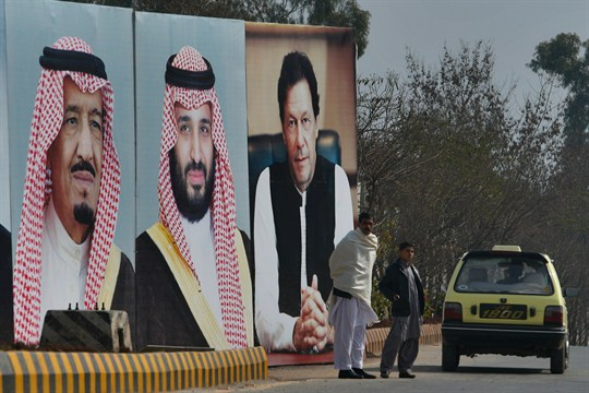Portraits of Saudi leaders along a highway outside Islambad, Pakistan.