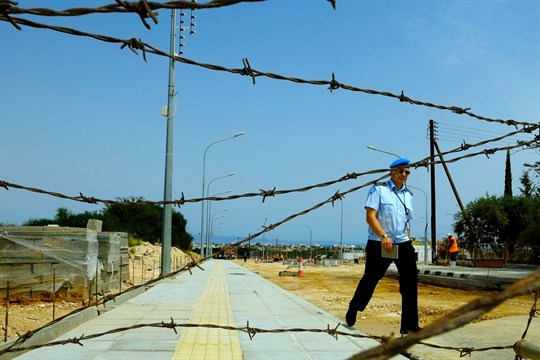 A U.N peacekeeper walks near a checkpoint in Cyprus.