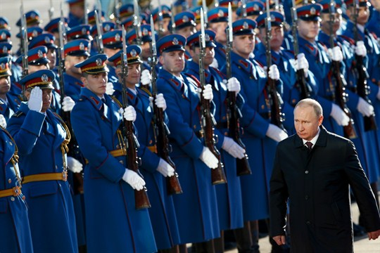 Russia's president, Vladimir Putin, walking in front of an honor guard of Serbian soldiers.