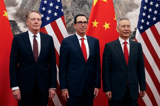 Robert Lighthizer, Steven Mnuchin, and Liu He standing in front of U.S. and Chinese flags.