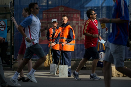 Municipal workers at Luzhniki Stadium in Moscow, Russia.