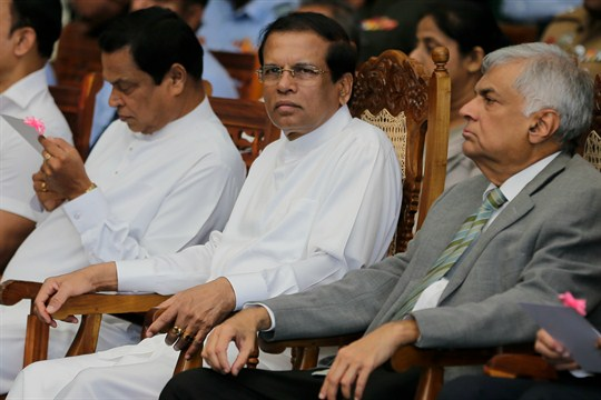Sri Lankan President Maithripala Sirisena, center, and Prime Minister Ranil Wickremesinghe, right, attend a ceremony Jayawardena