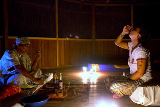 An Italian tourist drinks ayahuasca during a session in Nuevo Egipto.