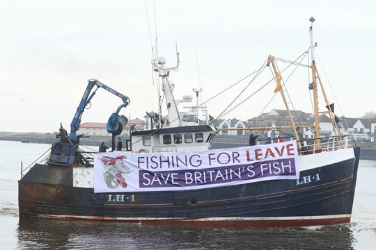 A fishing boat displays a pro-Brexit banner, near Newcastle, United Kingdom.