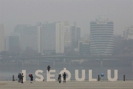 The Seoul cityscape, covered with a thick haze of fine dust particles.