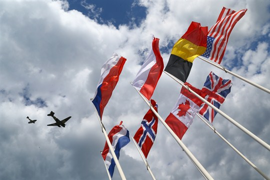Planes from the Battle of Britain memorial flight pass over Arromanches, France.