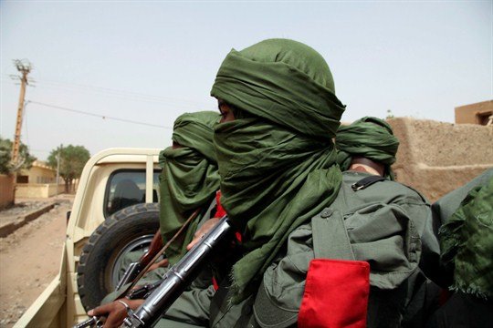 Malian troops join with former rebels during a joint patrol in Gao, Mali