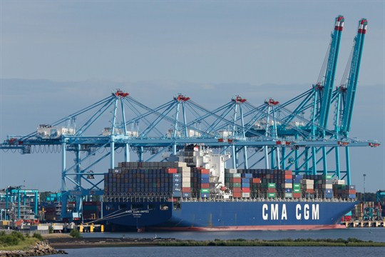 A container ship is unloaded at the Virginia International Gateway terminal in Norfolk, Va.
