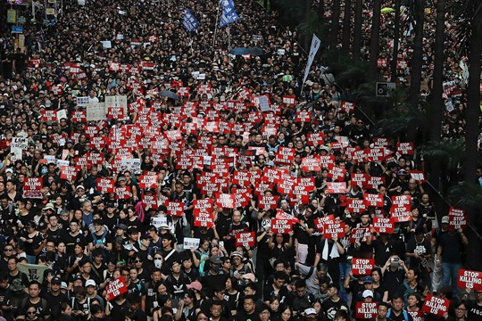 Tens of thousands of protesters demonstrate against an extradition bill in Hong Kong.