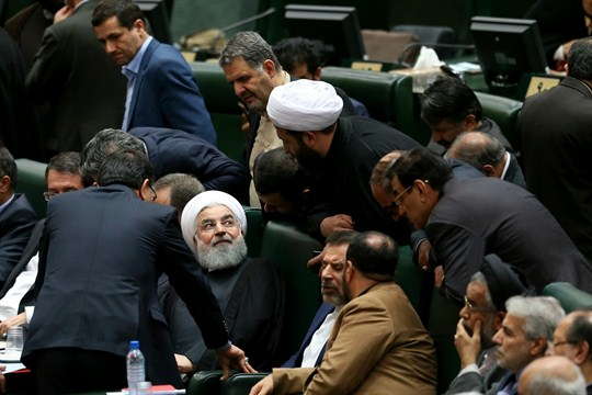 Iranian President Hassan Rouhani, center, speaks with the lawmakers during a parliamentary session in Tehran.