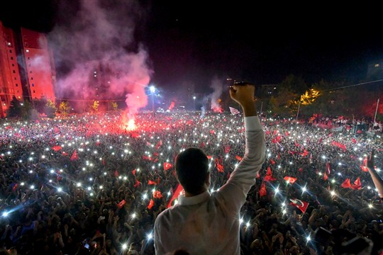 Opposition candidate Ekrem Imamoglu waves to supporters at rally after winning Istanbul's repeat mayor election.