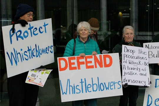 Whistleblower supporters demonstrate outside the Australian Capital Territory Supreme Court in Canberra.