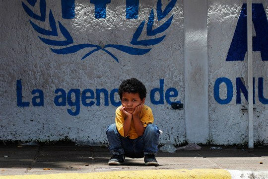 A child migrant from Central America waits outside a U.N. office in Tapachula, Mexico.