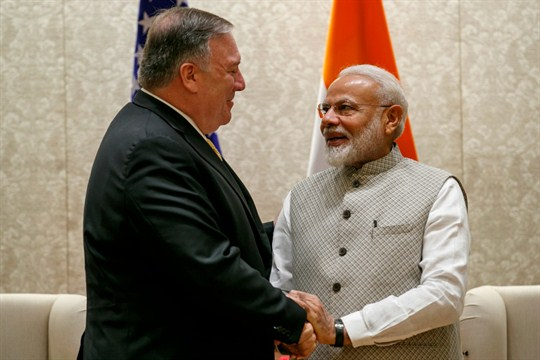 Secretary of State Mike Pompeo shakes hands with Indian Prime Minister Narendra Modi.