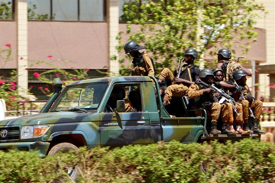 Troops ride in a vehicle near central Ouagadougou, Burkina Faso, the site of an emerging conflict.