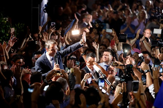 Kyriakos Mitsotakis, the leader of the New Democracy party, waves to his supporters, in Athens.