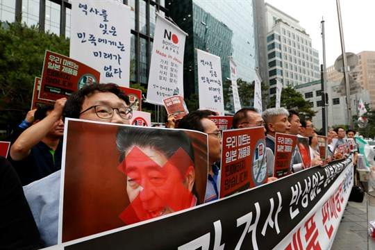 South Korean business owners stage a rally calling for a boycott of Japanese products.