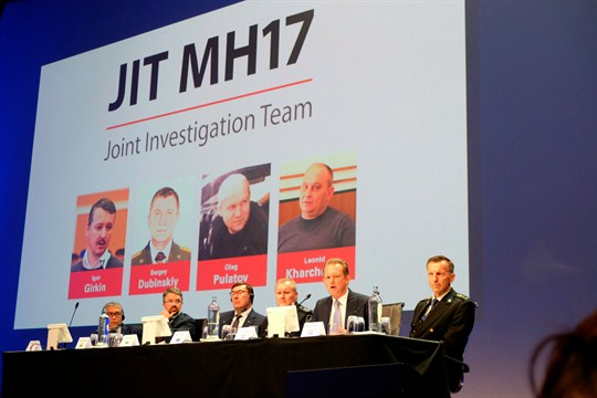 A press conference announcing charges against three Russians and a Ukrainian over the downing of MH17.
