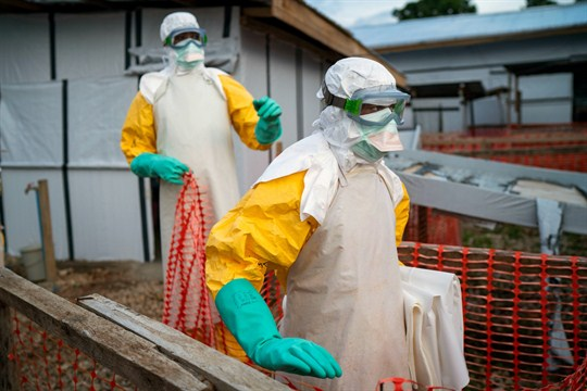Health workers wearing protective suits take their shift at a treatment center in Beni, Congo.