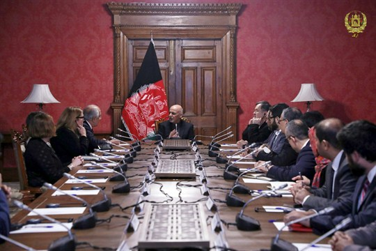 Afghan President Ashraf Ghani, center, speaks to U.S. peace envoy Zalmay Khalilzad, third left, in Kabul