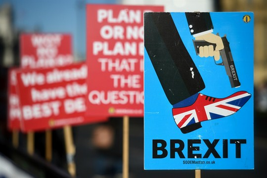 Anti-Brexit campaigners' placards outside the Houses of Parliament, London.