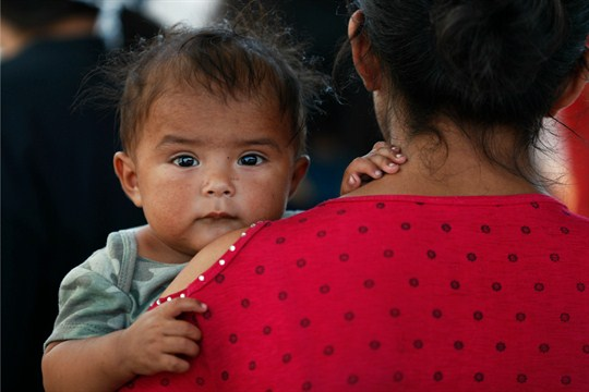 A Honduran migrant mother and her child at an immigration center in Nuevo Laredo, Mexico