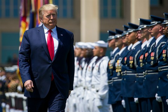 President Donald Trump reviews the troops at the Pentagon