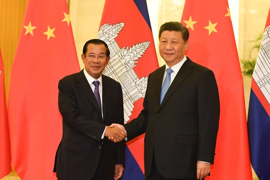 Cambodian Prime Minister Hun Sen, left, shakes hands with Chinese President Xi Jinping in Beijing