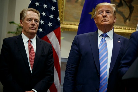 President Donald Trump stands with U.S. Trade Representative Robert Lighthizer in the White House.