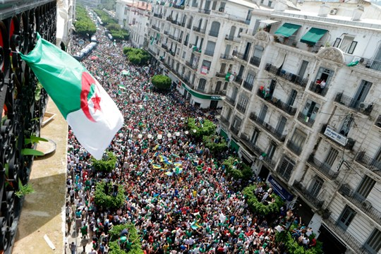 Protesters take part in a march in Algiers calling for the departure of the Algerian regime.