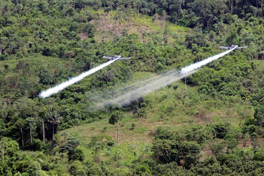 Two AT-802 planes are seen fumigating coca fields in San Miguel, Colombia.